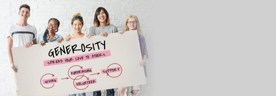 group of people holding generosity word in tarp